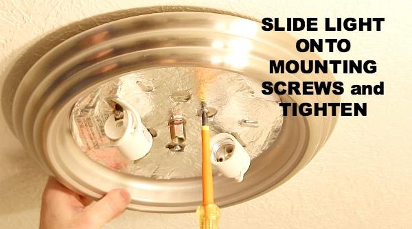 Slide light onto mounting screws