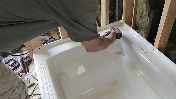 Pre-drill tub lip