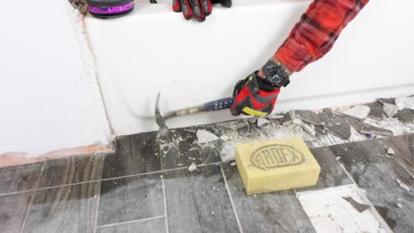 Smash Tile Floors with Hammer